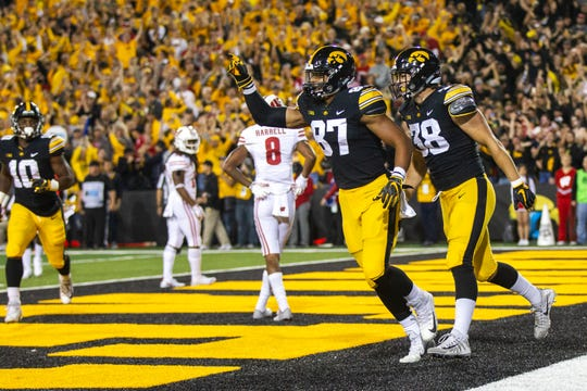 Noah Fant (87) celebrates a Sept. 22 touchdown against Wisconsin with T.J. Hockenson (38).