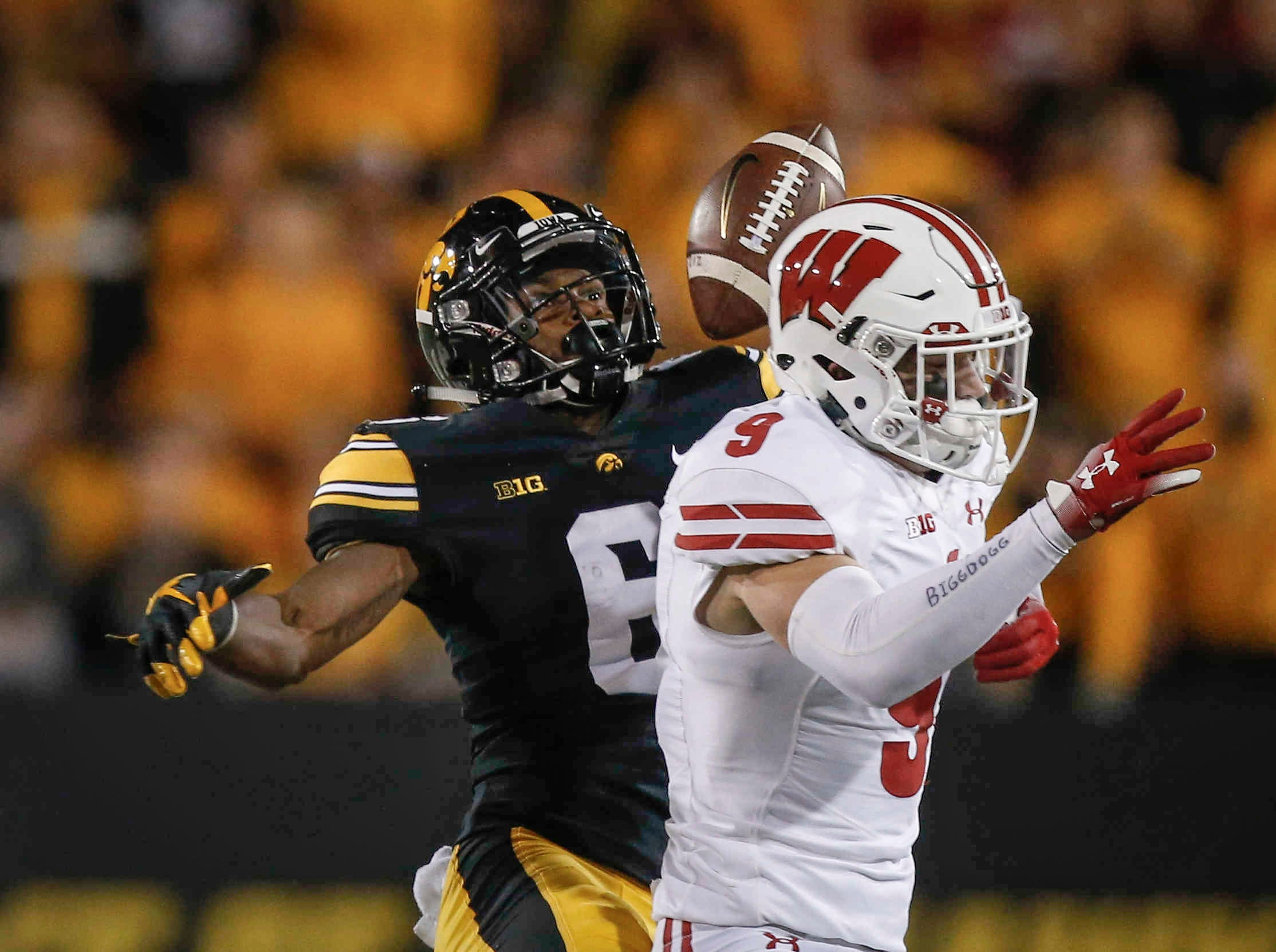 Iowa receiver Ihmir Smith-Marsette loses the ball after being hit by Wisconsin safety Scott Nelson on Saturday, Sept. 22, 2018, at Kinnick Stadium in Iowa City.