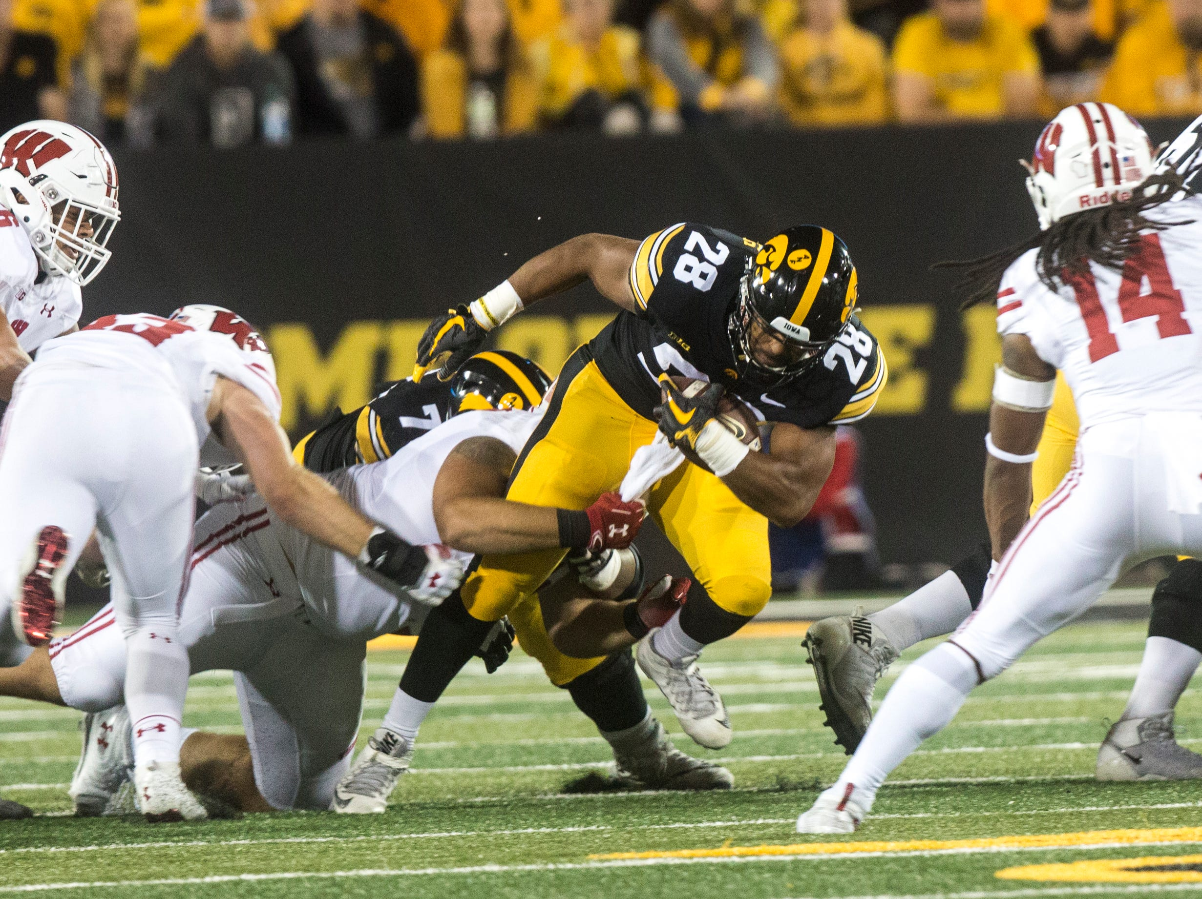 Iowa running back Toren Young (28) gets tackled during an NCAA football game on Saturday, Sept. 22, 2018, at Kinnick Stadium in Iowa City.