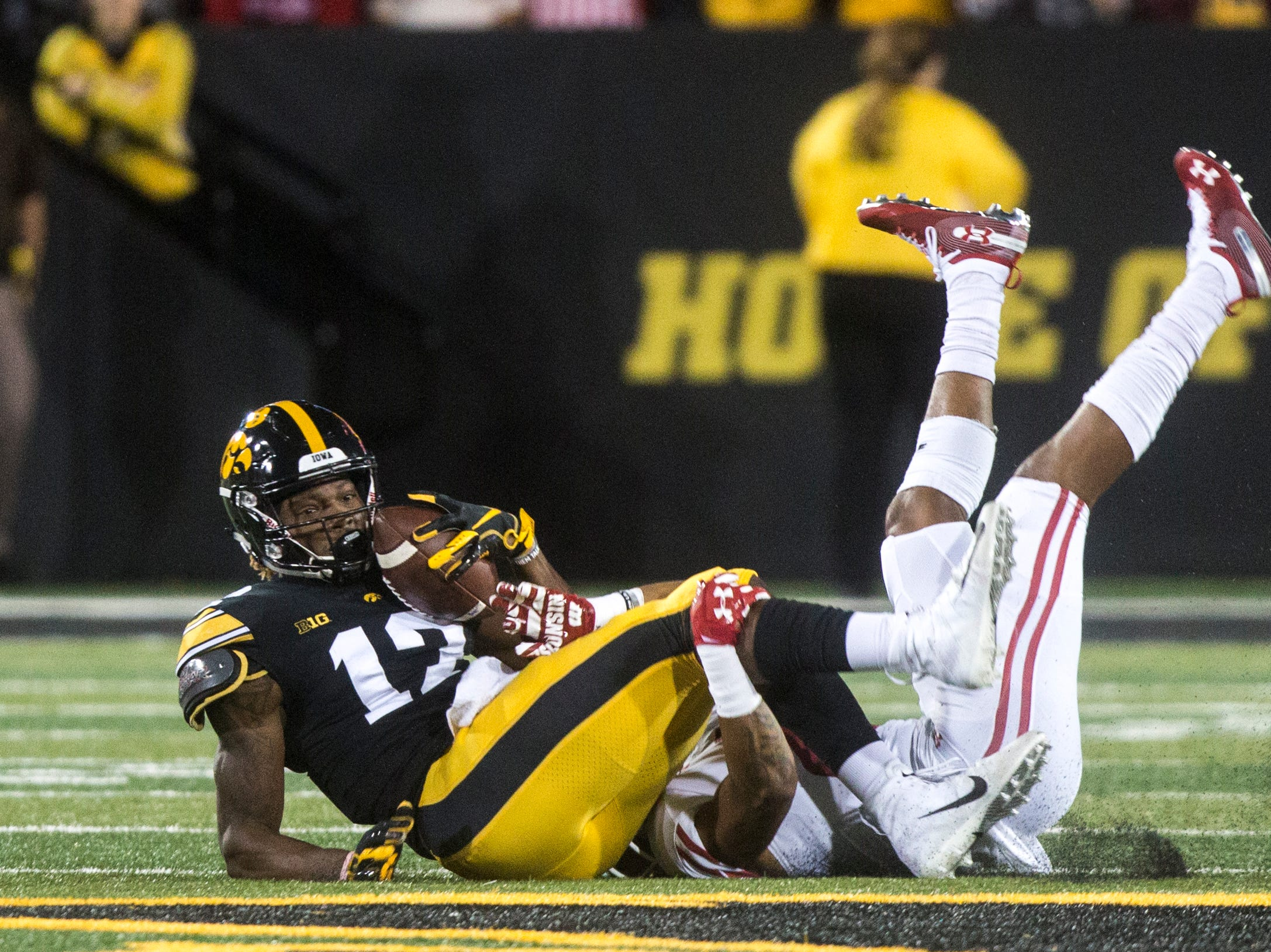 Iowa wide receiver Brandon Smith (12) comes down with a ball during an NCAA football game on Saturday, Sept. 22, 2018, at Kinnick Stadium in Iowa City.