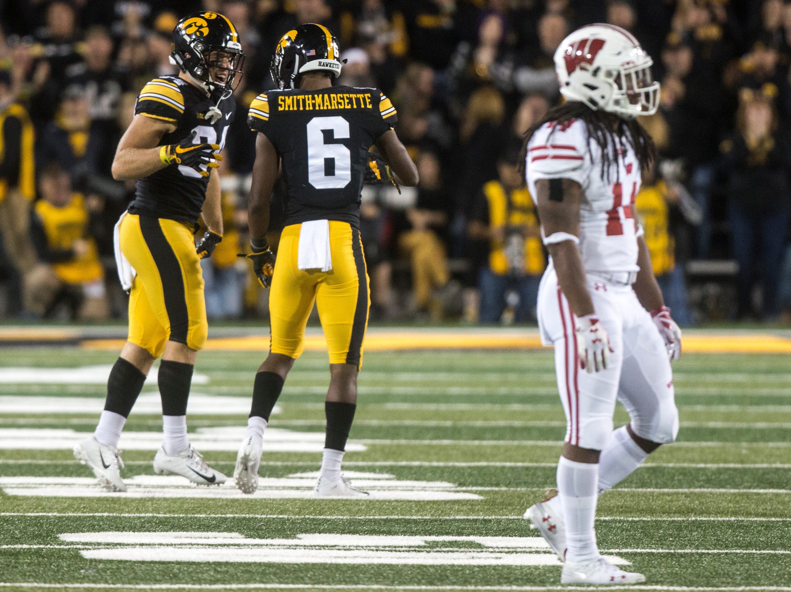 Iowa wide receiver Nick Easley (84) celebrates with Iowa wide receiver Ihmir Smith-Marsette (6) during an NCAA football game on Saturday, Sept. 22, 2018, at Kinnick Stadium in Iowa City.
