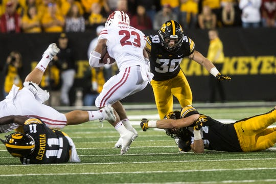Wisconsin running back Jonathan Taylor (23) has rushed for 270 yards in two victories over Iowa. Hawkeye safety Jake Gervase stopped him on this play a year ago, but Iowa knows this Saturday it will need to devote more attention to the Badgers star.