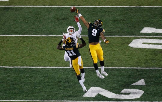 Iowa safety Geno Stone (9) knocked this pass away from a Wisconsin receiver last season. Stone took over a starting spot after that game and is now preparing to be a leader in the secondary as a Hawkeye junior.
