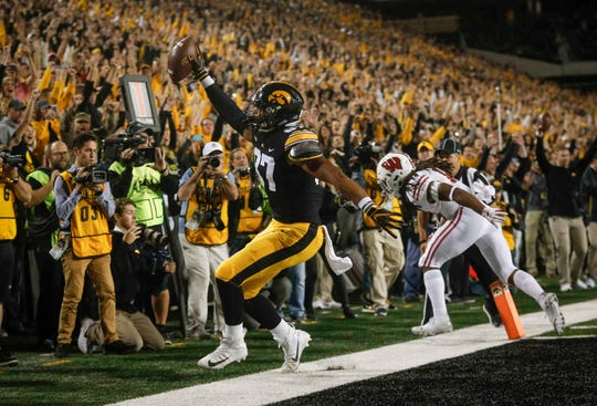 Iowa tight end Noah Fant scores a touchdown in the third quarter against Wisconsin on Saturday, Sept. 22, 2018, at Kinnick Stadium in Iowa City.