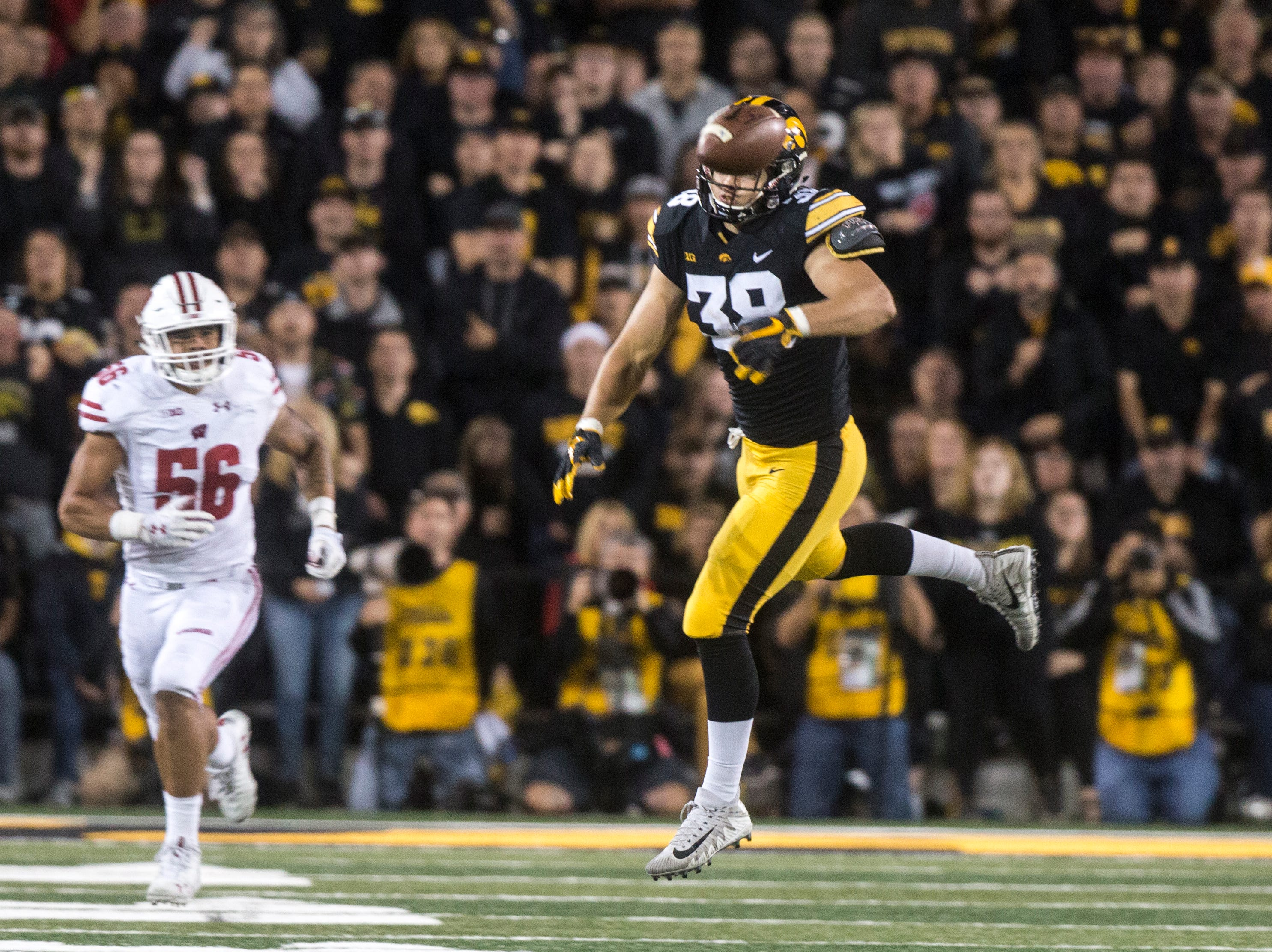 Iowa tight end T.J. Hockenson (38) can't come up with a reception during an NCAA football game on Saturday, Sept. 22, 2018, at Kinnick Stadium in Iowa City.