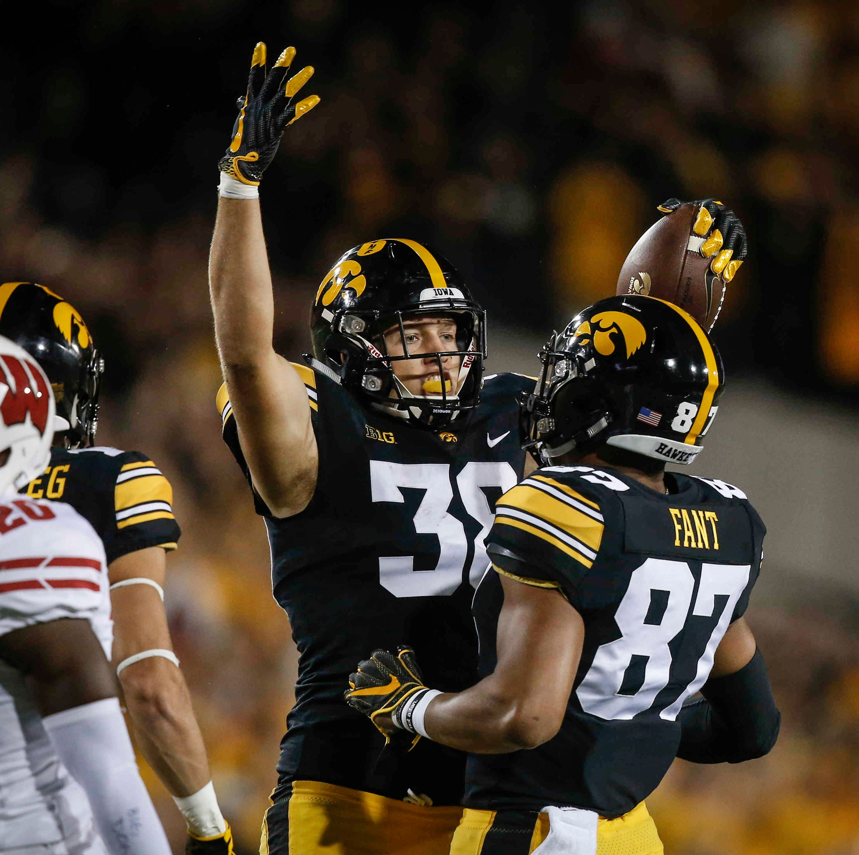 Iowa tight end T.J. Hockenson celebrates with teammate Noah Fant after pulling in a catch for a first down against Wisconsin on Saturday, Sept. 22, 2018, at Kinnick Stadium in Iowa City.