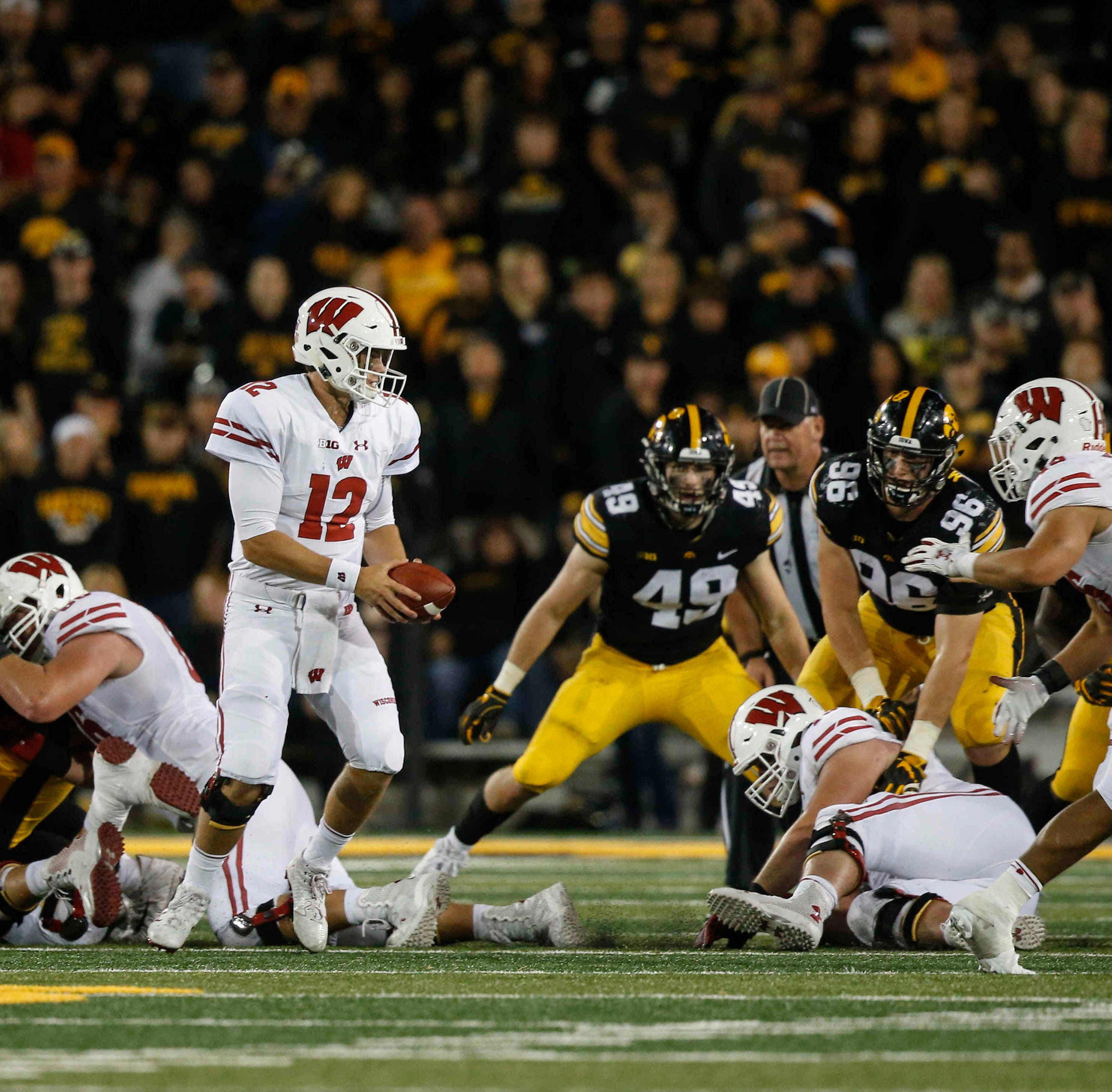 Iowa gives Wisconsin quarterback one opportunity too many, and pays the price