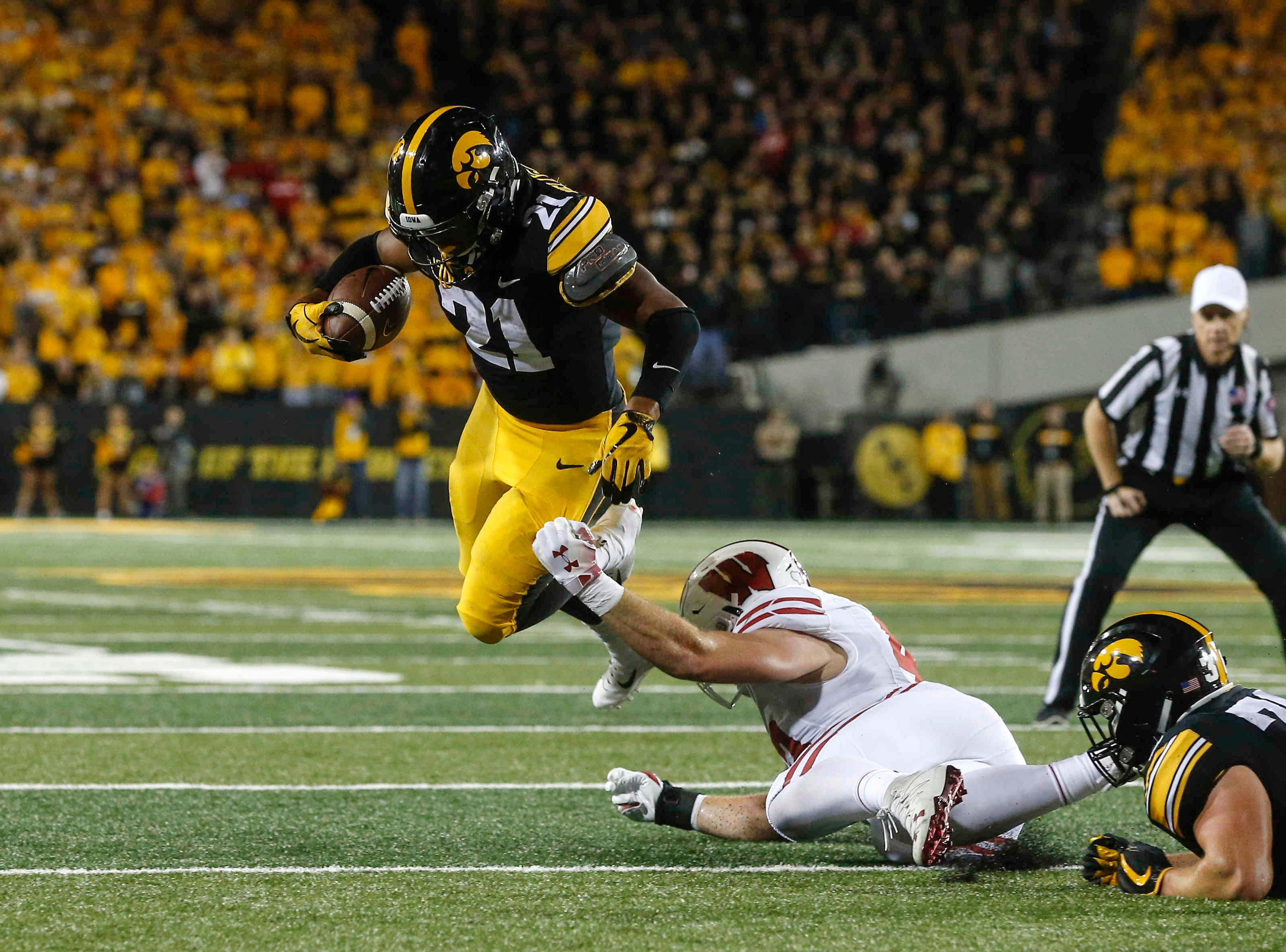Iowa running back Ivory Kelly-Martin is tripped up by a Wisconsin linebacker on Saturday, Sept. 22, 2018, at Kinnick Stadium in Iowa City.