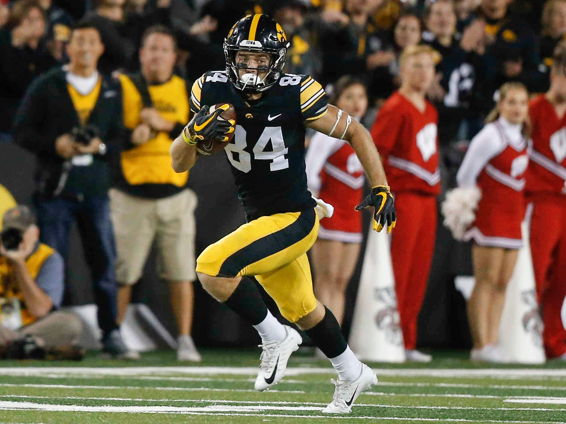 Iowa receiver Nick Easley runs the ball after pulling in a reception against Wisconsin on Saturday, Sept. 22, 2018, at Kinnick Stadium in Iowa City.
