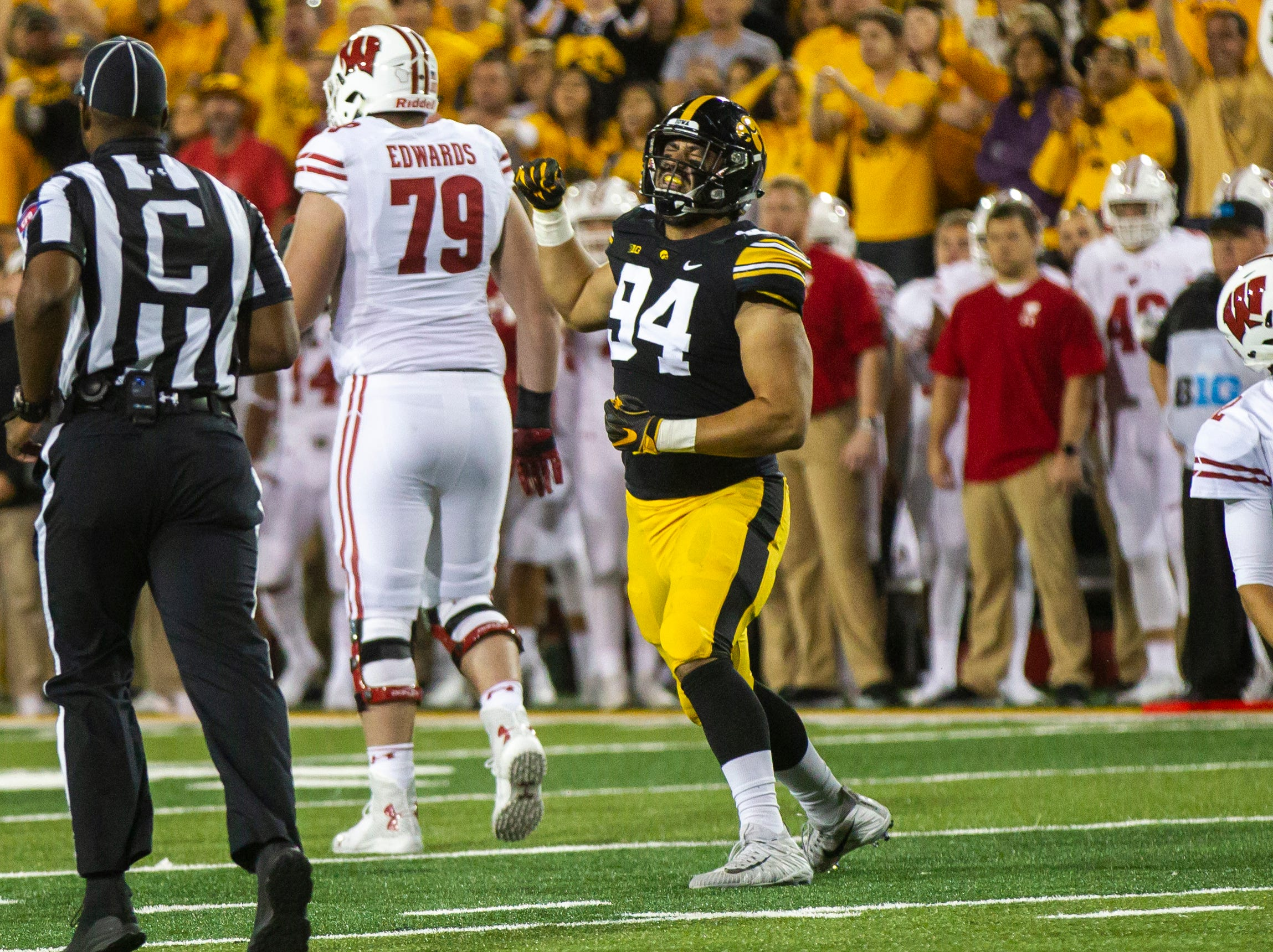 Iowa defensive end A.J. Epenesa (94) celebrates after a sack during an NCAA football game on Saturday, Sept. 22, 2018, at Kinnick Stadium in Iowa City.
