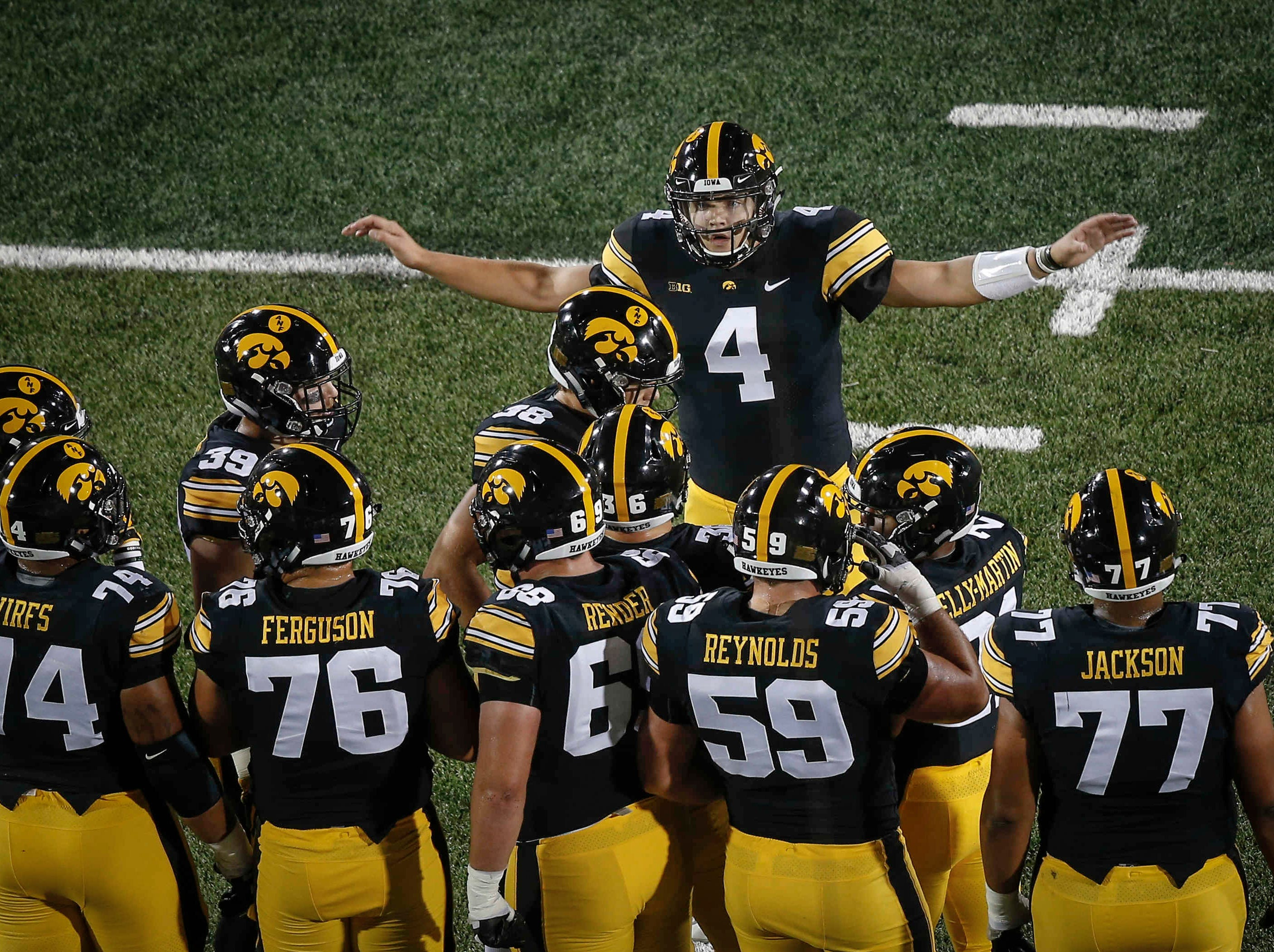 Iowa junior quarterback Nate Stanley calls a play to his offense against Wisconsin in the first quarter on Saturday, Sept. 22, 2018, at Kinnick Stadium in Iowa City.