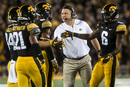 Iowa offensive coordinator Brian Ferentz high-fives players during Saturday's 28-17 loss to Wisconsin. Iowa averaged 7.5 yards per play in the game and 8.0 yards on first-and-10.