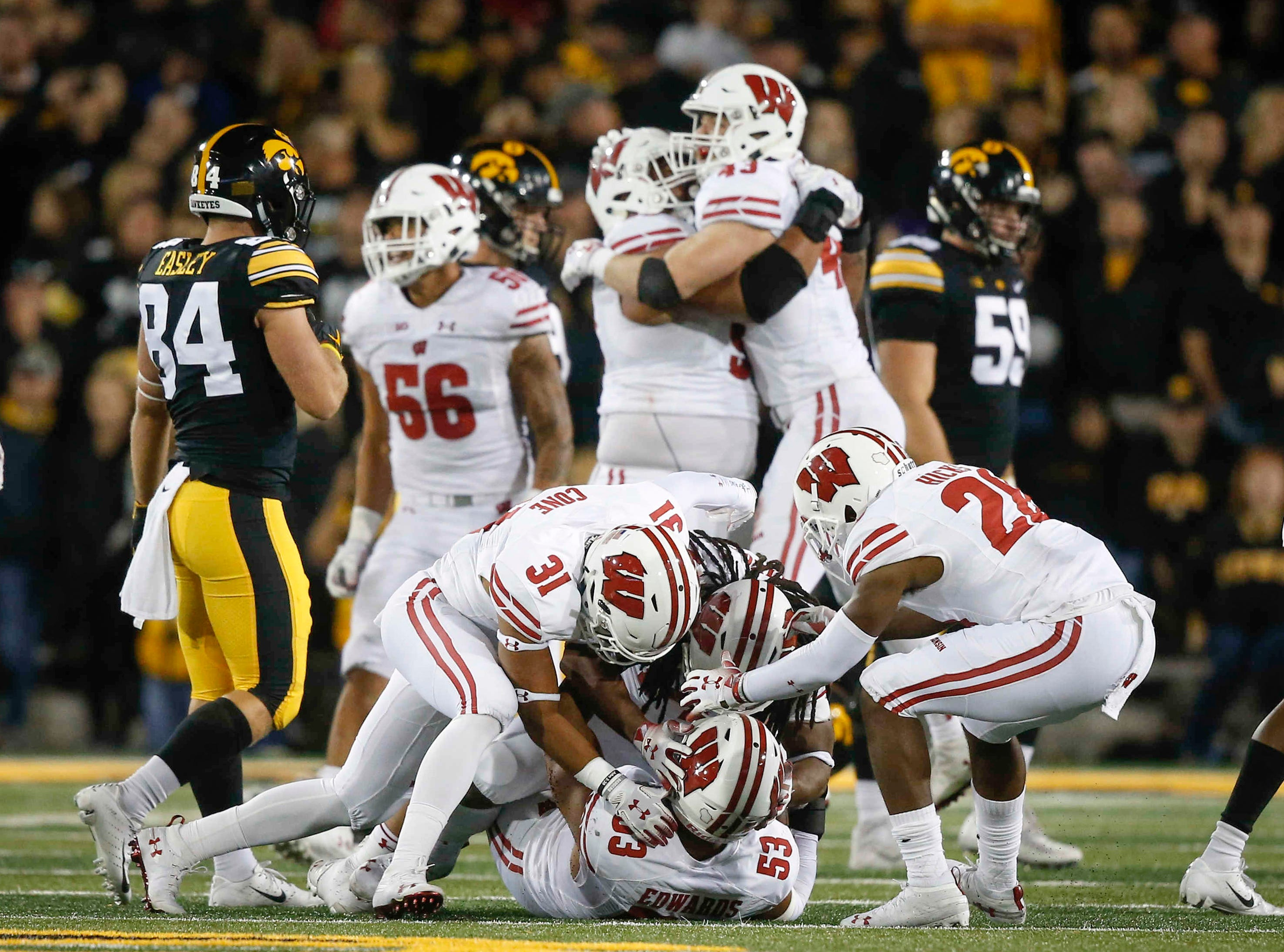 Members of the Wisconsin defense celebrate after pulling in an interception against Iowa quarterback Nate Stanley on Saturday, Sept. 22, 2018, at Kinnick Stadium in Iowa City.