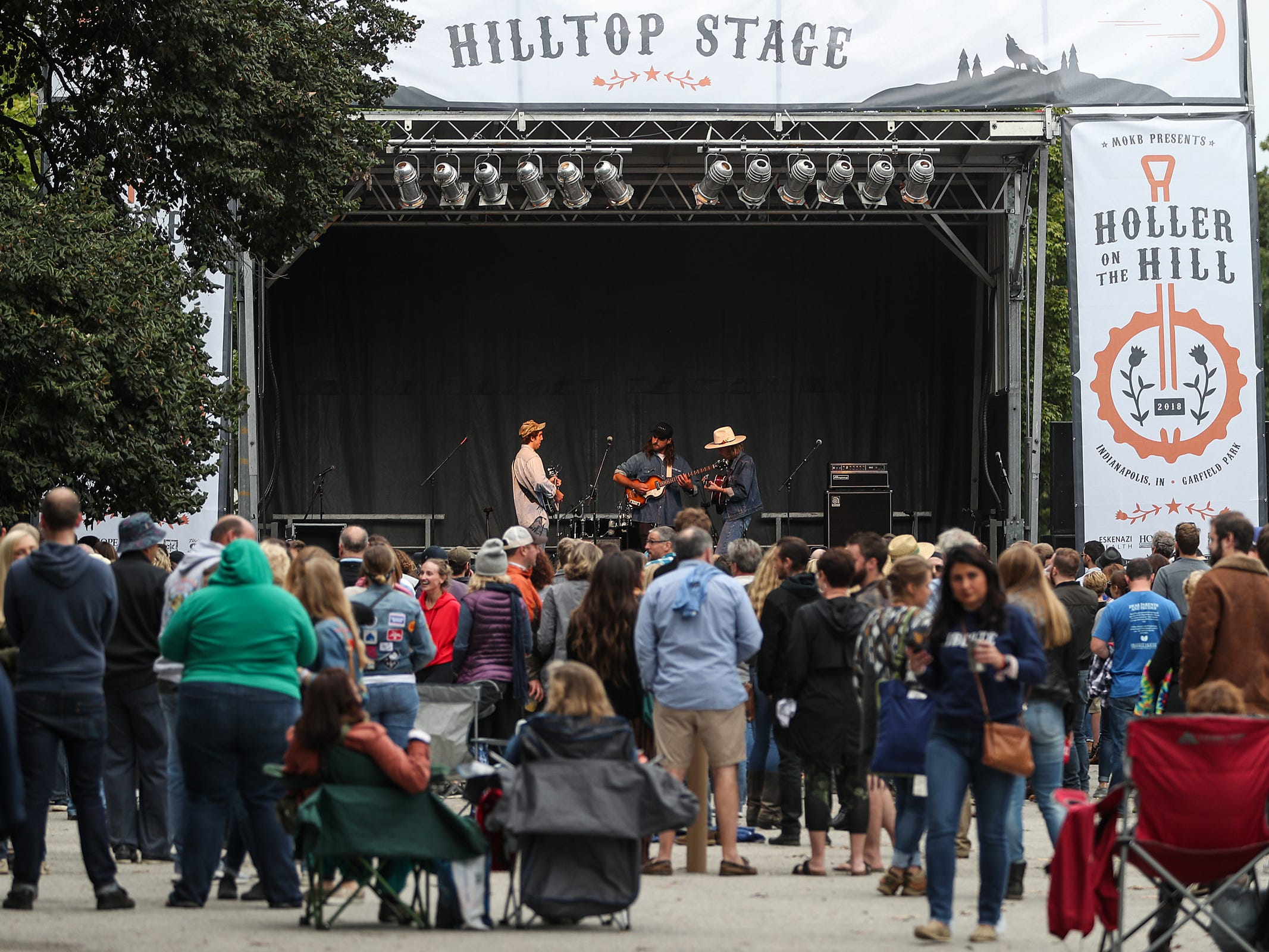 Spectators listen to Caamp's performance at the inaugural Holler on the Hill music festival at Garfield Park in Indianapolis, Saturday, Sept. 22, 2018. The festival features more than 30 performers across three stages on September 22 and 23.