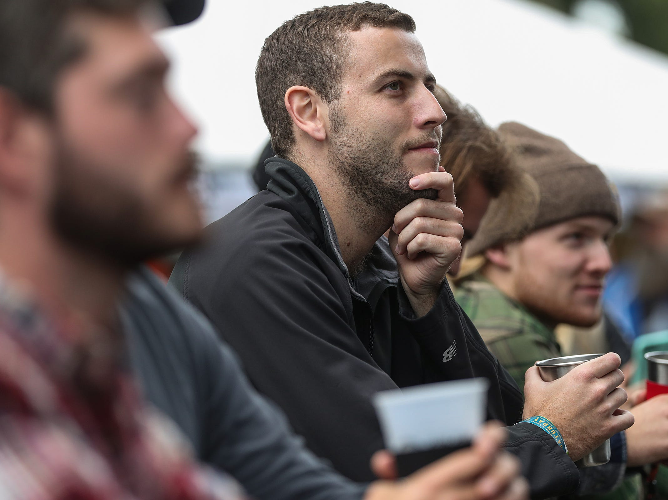Spectators listen to Ohio-based folk group Caamp at the inaugural Holler on the Hill music festival at Garfield Park in Indianapolis, Saturday, Sept. 22, 2018.