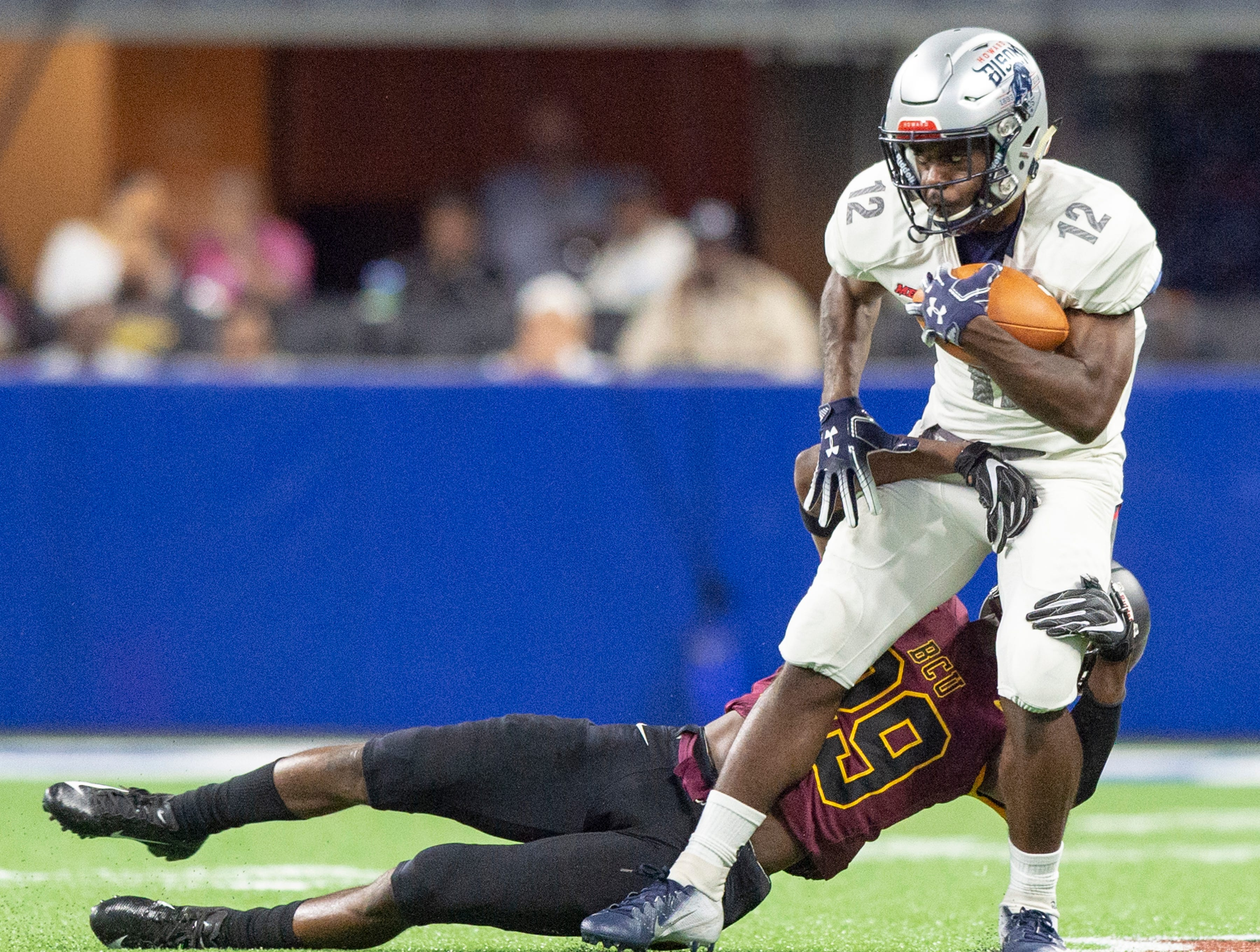Howard Bison wide receiver Jequez Ezzard (12) tries to make a move upfield during the first half of action. Howard Bison took on Bethune Cookman Wildcats in the Circle City Classic game, Saturday, Sept. 22, 2018, at Lucas Oil Stadium.