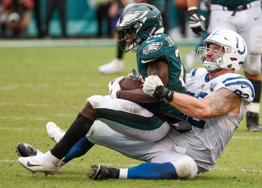 Indianapolis Colts defensive end Margus Hunt (92) wraps up Philadelphia Eagles running back Wendell Smallwood (28) at Lincoln Financial Field in Philadelphia, on Sunday, Sept. 23, 2018.