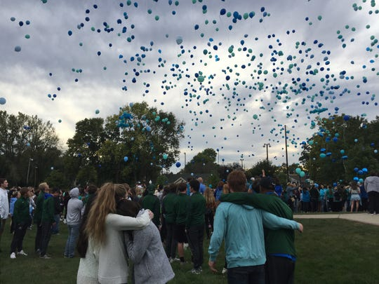 Hundreds of people release balloons into the sky during a prayer vigil for Harrison Hunn, 15, and Shelby Hunn, 13, at Lions Park in Zionsville.