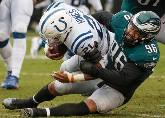 Indianapolis Colts running back Nyheim Hines (21) is wrapped up by Philadelphia Eagles defensive end Derek Barnett (96) at Lincoln Financial Field in Philadelphia, on Sunday, Sept. 23, 2018.