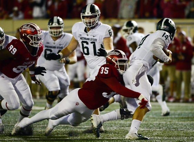 Indiana Hoosiers defensive lineman Nile Sykes (35) tackles Michigan State quarterback Brian Lewerke (14) during the game against Michigan State at Memorial Stadium in Bloomington, Ind., on Saturday, Sept. 22, 2018.