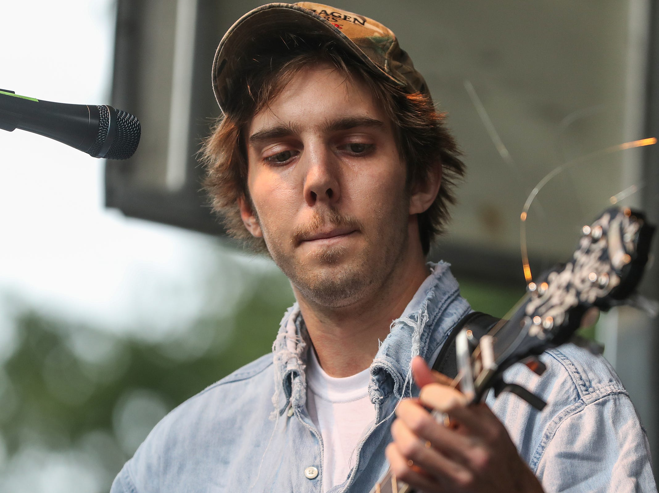 Banjo-player and vocalist Evan Westfall performs with Ohio-based folk group Caamp at the inaugural Holler on the Hill music festival at Garfield Park in Indianapolis, Saturday, Sept. 22, 2018.