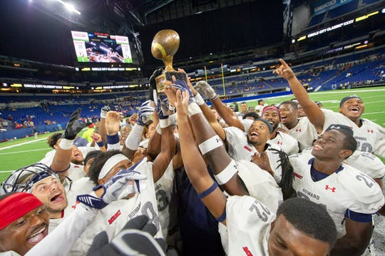Howard University Bisons celebrate with their trophy after winning the game.
