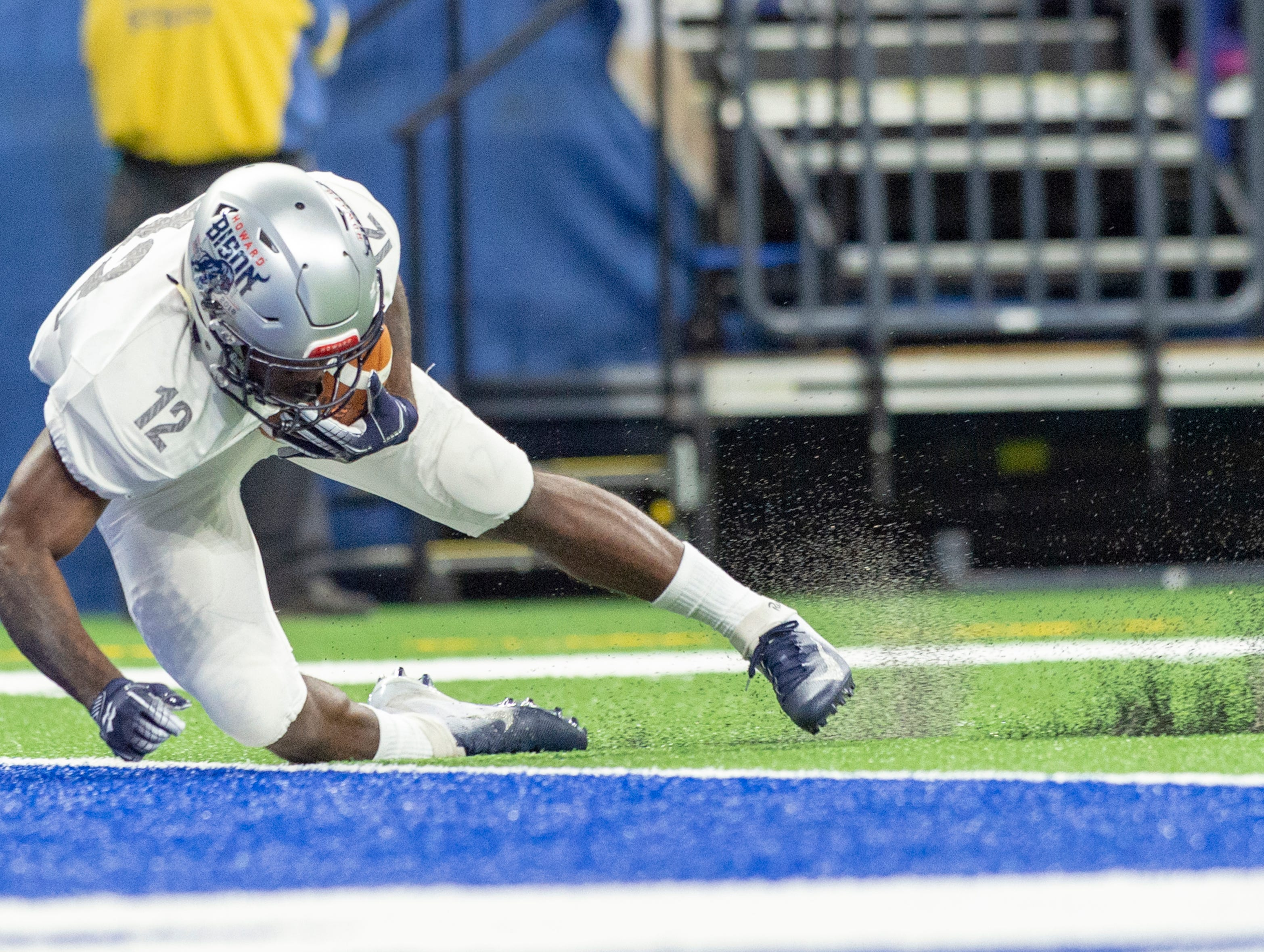 Howard Bison wide receiver Jequez Ezzard (12) stops the punted ball just short of the goalie during the first half of action. Howard Bison took on Bethune Cookman Wildcats in the Circle City Classic game, Saturday, Sept. 22, 2018, at Lucas Oil Stadium.