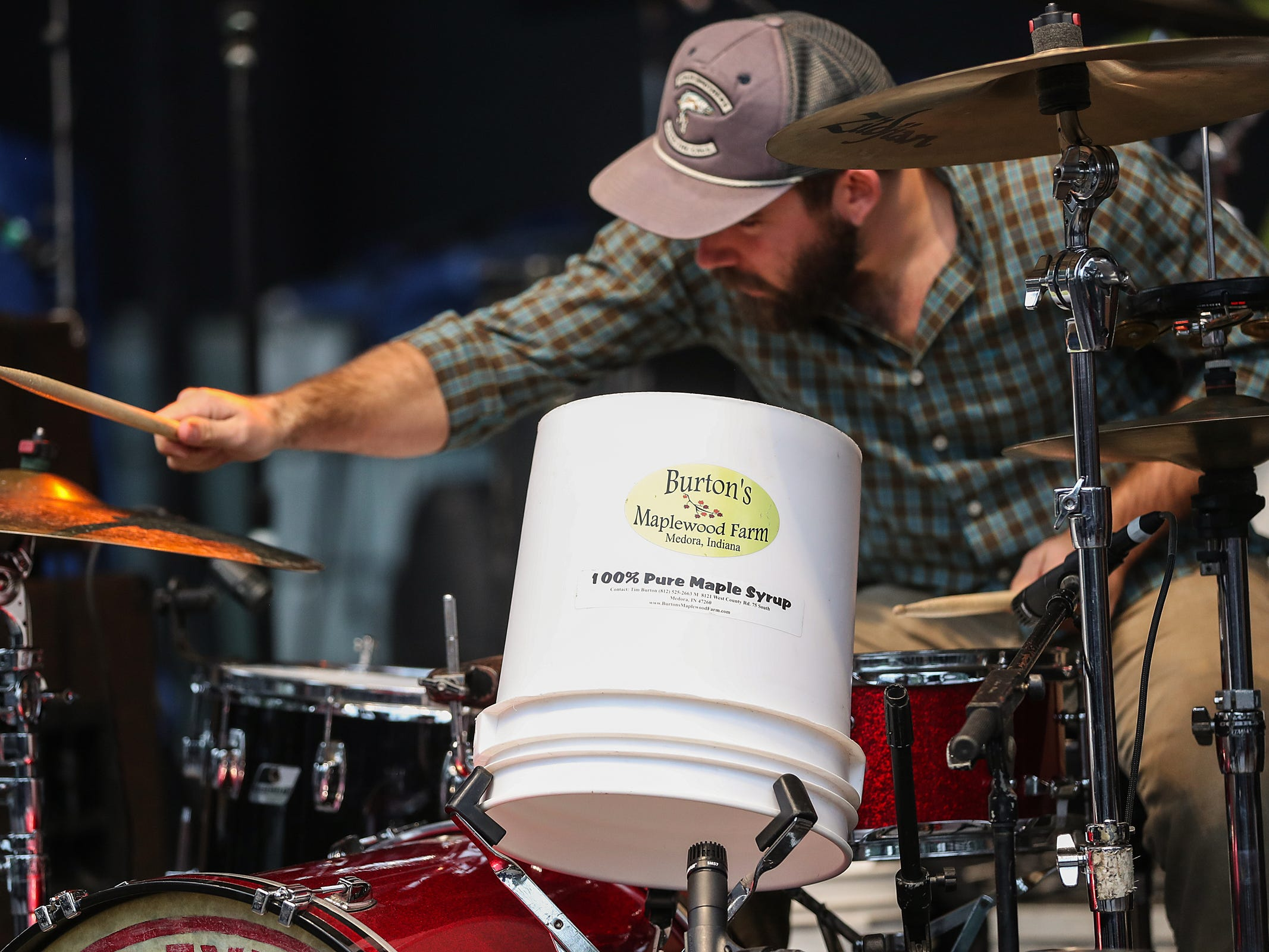 Max Senteney plays drums, including a maple syrup bucket, in three-piece country blues group Reverend Peyton's Big Damn Band, of Brown County, Ind., at the inaugural Holler on the Hill music festival at Garfield Park in Indianapolis, Saturday, Sept. 22, 2018.