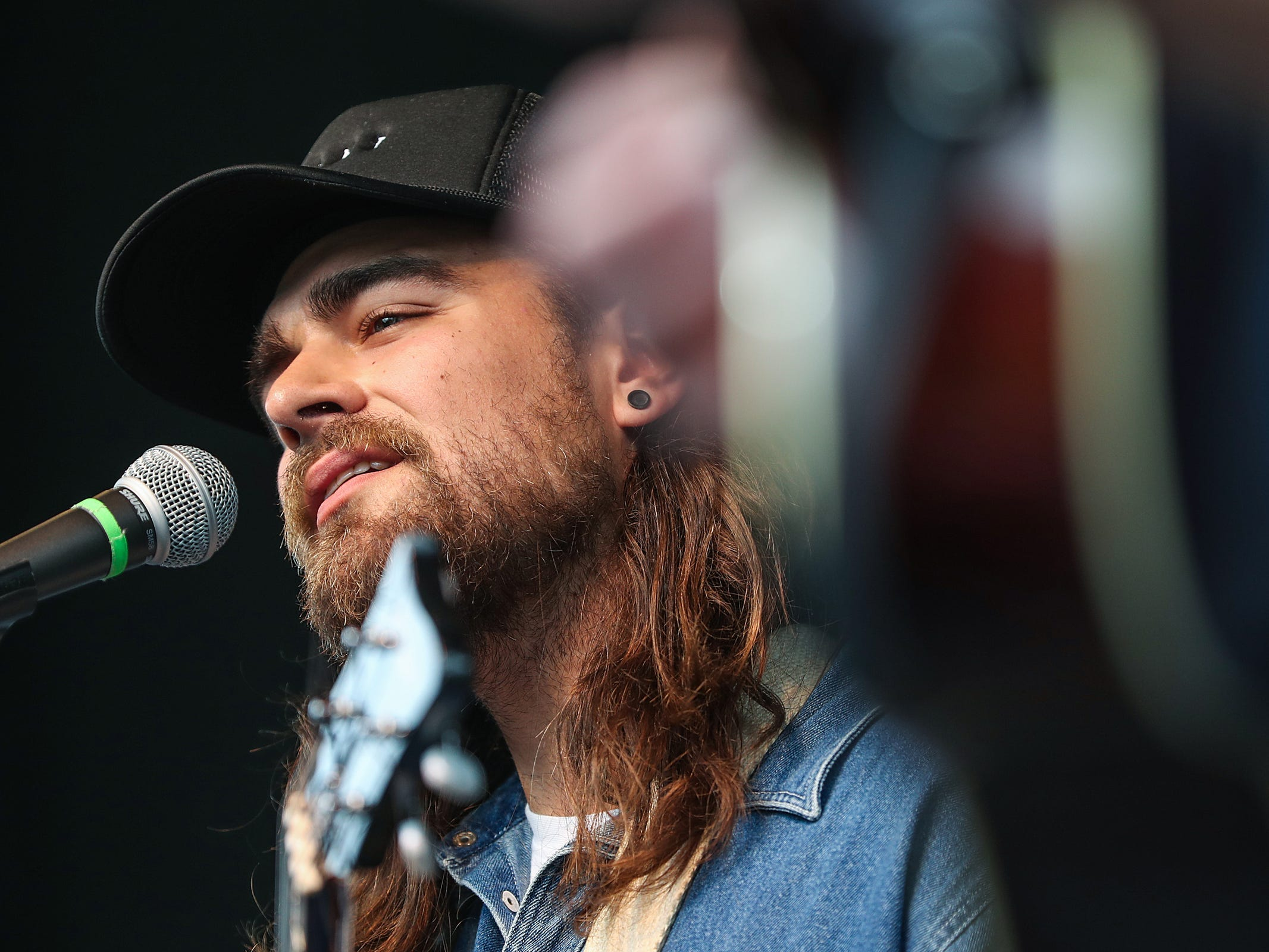 Bassist and vocalist Matt Vinson performs with Ohio-based folk group Caamp at the inaugural Holler on the Hill music festival at Garfield Park in Indianapolis, Saturday, Sept. 22, 2018.