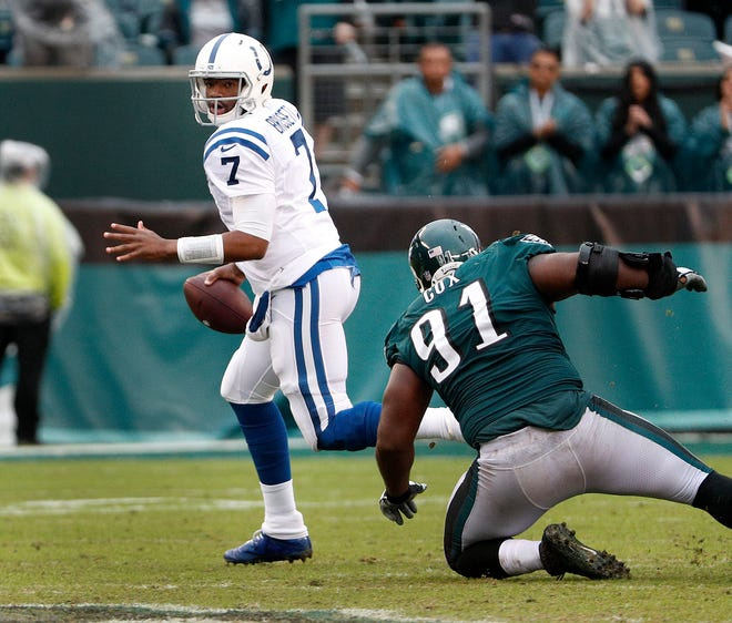Indianapolis Colts quarterback Jacoby Brissett (7) scrambles away from Philadelphia Eagles defensive end Fletcher Cox (91) on the Colts final play of the game in the fourth quarter at Lincoln Financial Field in Philadelphia, PA. on Sunday, Sept. 23, 2018.