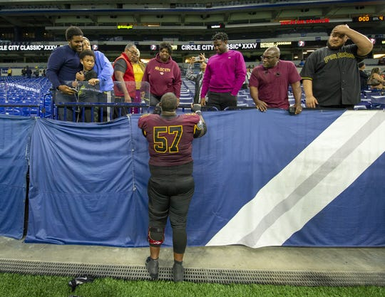 Bethune Cookman Wildcats offensive lineman Dwayne Brown (57) meets with his family in the stands after the game, Saturday, Sept. 22, 2018.