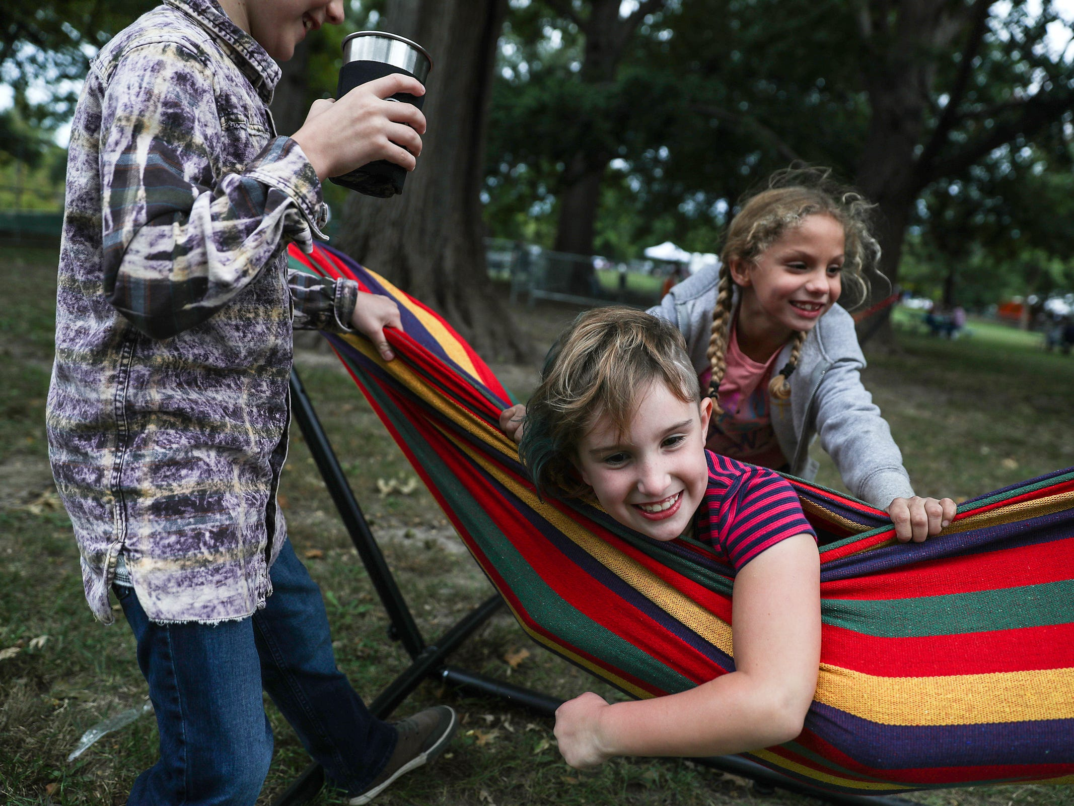 Kids play on hammocks at the inaugural Holler on the Hill music festival at Garfield Park in Indianapolis, Saturday, Sept. 22, 2018.