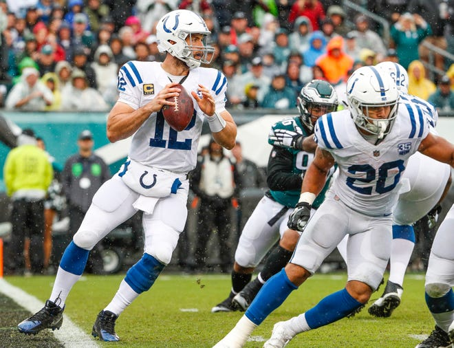 Indianapolis Colts quarterback Andrew Luck (12) drops back to pass near the Colts' end zone against the Philadelphia Eagles at Lincoln Financial Field in Philadelphia, on Sunday, Sept. 23, 2018.