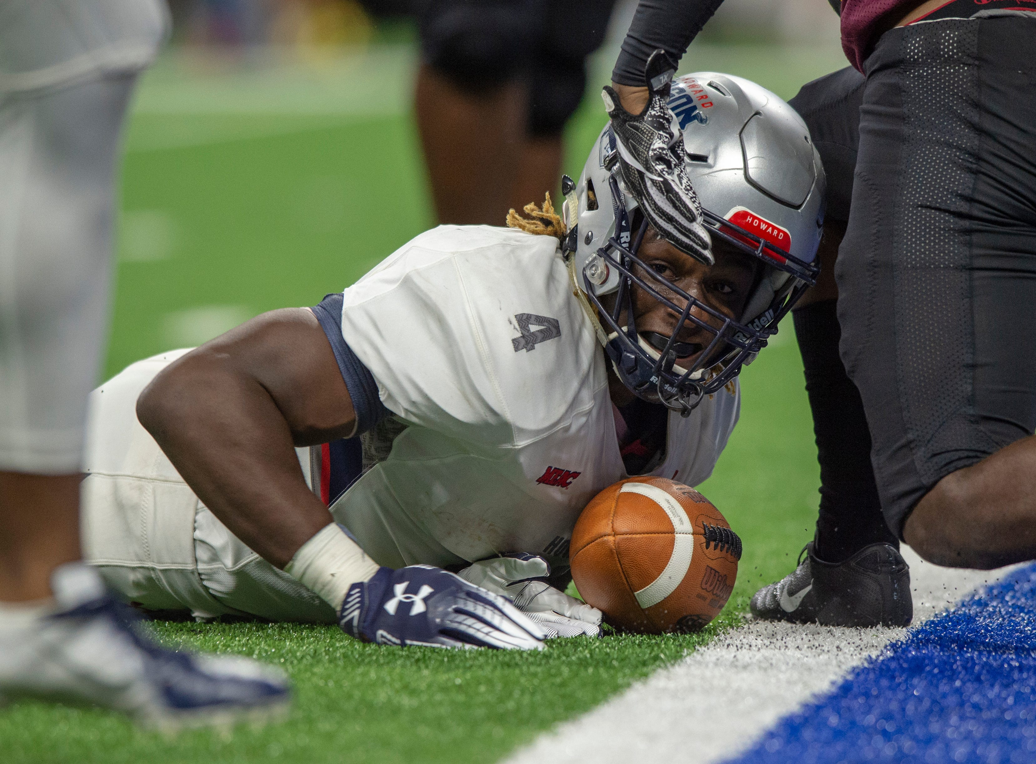 Howard Bison running back Iggy Reynoso (4) looks to see if he made the touchdown during the second half of action. Howard Bison took on Bethune Cookman Wildcats in the Circle City Classic game, Saturday, Sept. 22, 2018, at Lucas Oil Stadium. Howard won 14-35.