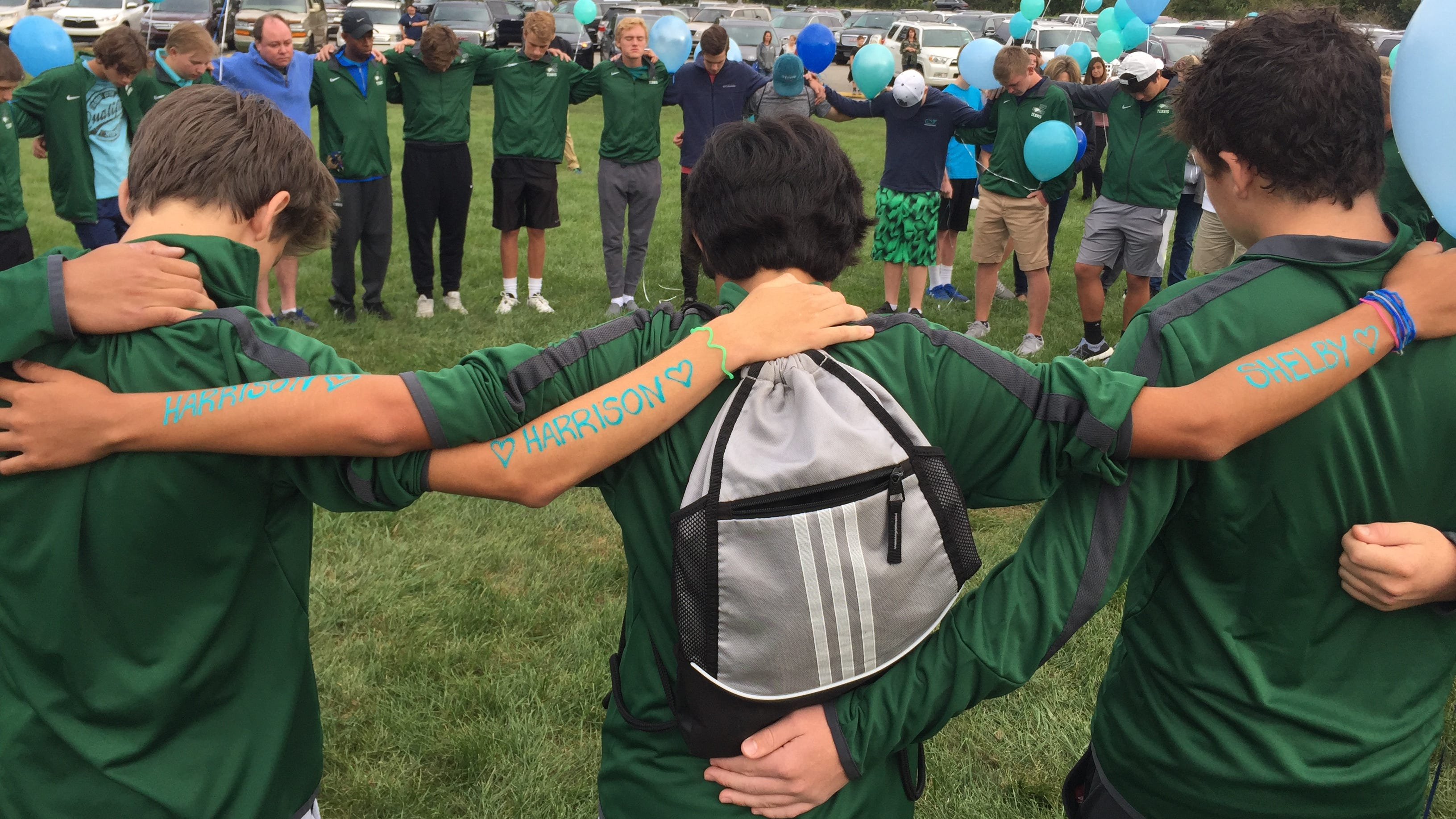 Zionsville locks arms to remember victims of suspected double murder-suicide