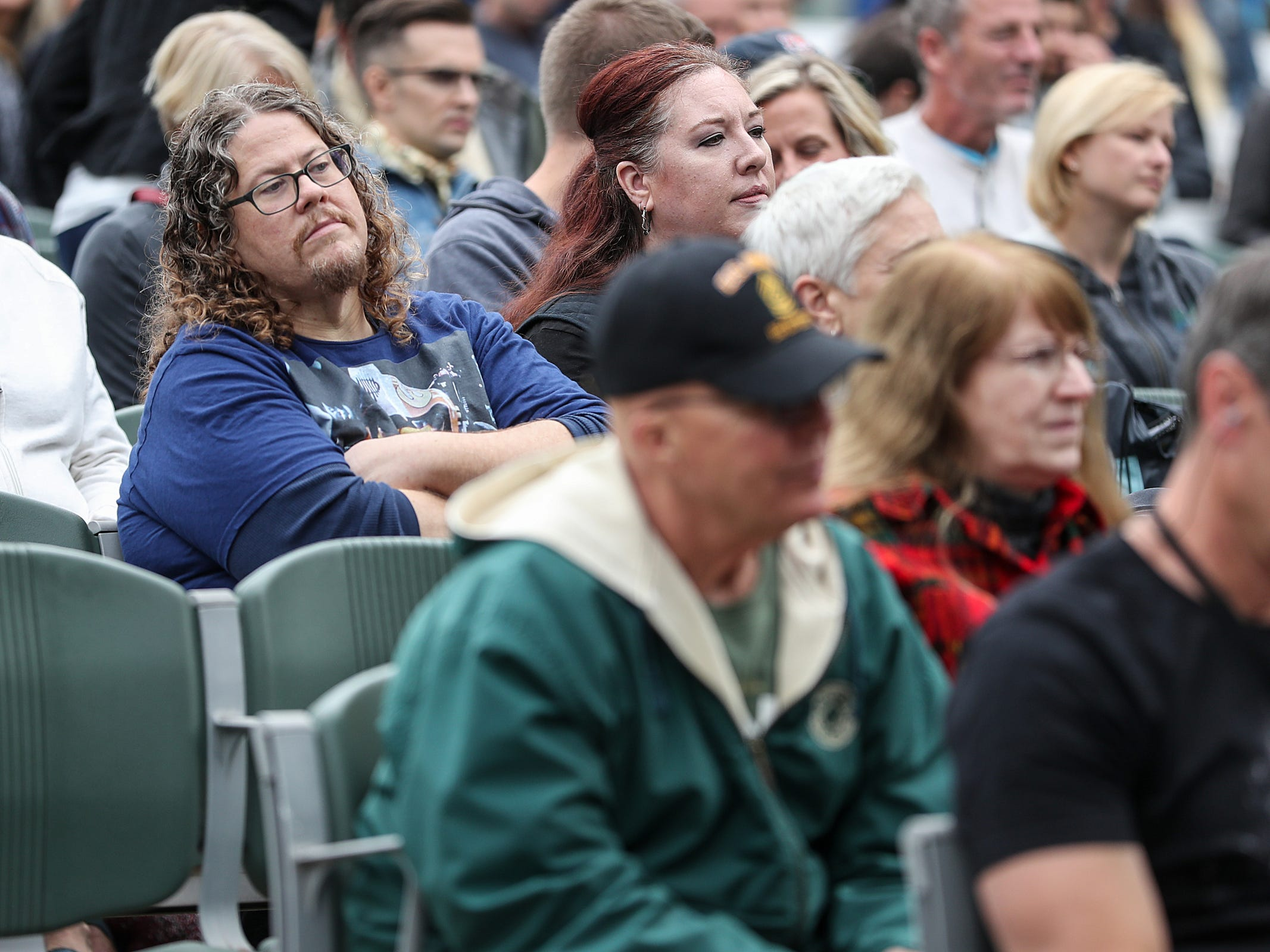 Spectators listen as Americana music artists perform at the inaugural Holler on the Hill music festival at Garfield Park in Indianapolis, Saturday, Sept. 22, 2018. The festival features more than 30 performers across three stages on September 22 and 23.