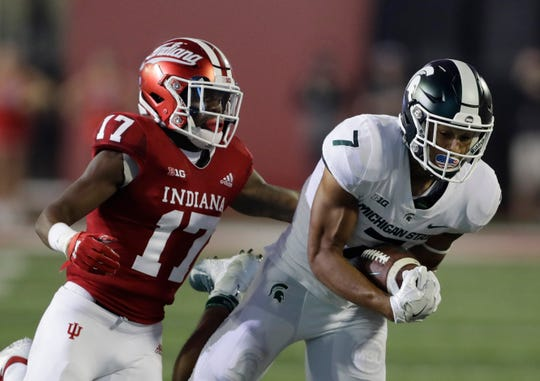 Michigan State wide receiver Cody White (7) makes a catch against Indiana's Raheem Layne during the first half of an NCAA college football game, Saturday, Sept. 22, 2018, in Bloomington, Ind. (AP Photo/Darron Cummings)