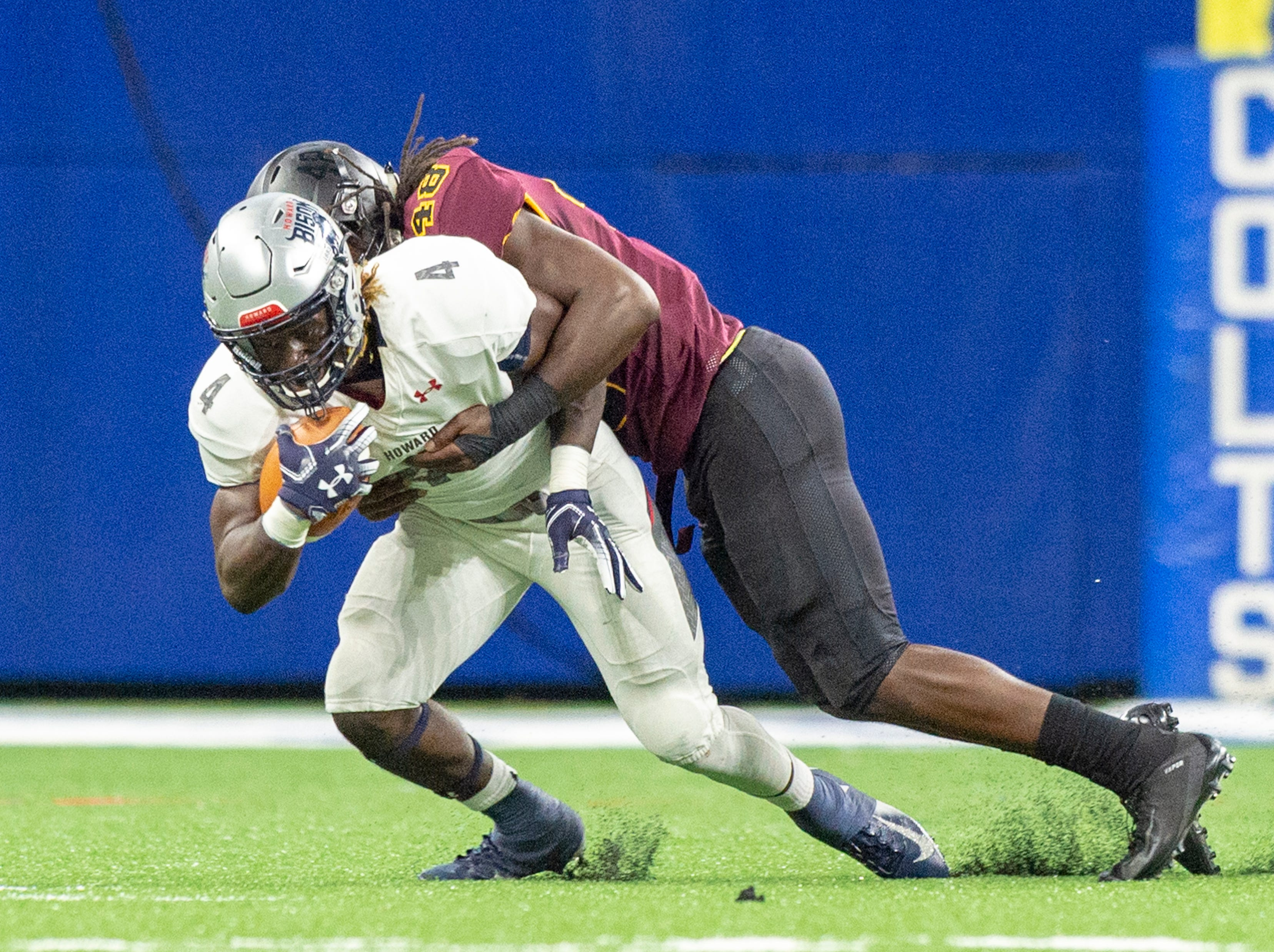 Howard Bison running back Iggy Reynoso (4) is hit by Bethune Cookman Wildcats defensive end Marques Ford (48) during the first half of action. Howard Bison took on Bethune Cookman Wildcats in the Circle City Classic game, Saturday, Sept. 22, 2018, at Lucas Oil Stadium.