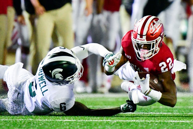 Sep 22, 2018; Bloomington, IN, USA; Indiana Hoosiers wide receiver Whop Philyor (22) dives to the ground while defended by Michigan State Spartans safety David Dowell (6) during the first half of the game at Memorial Stadium . Mandatory Credit: Marc Lebryk-USA TODAY Sports