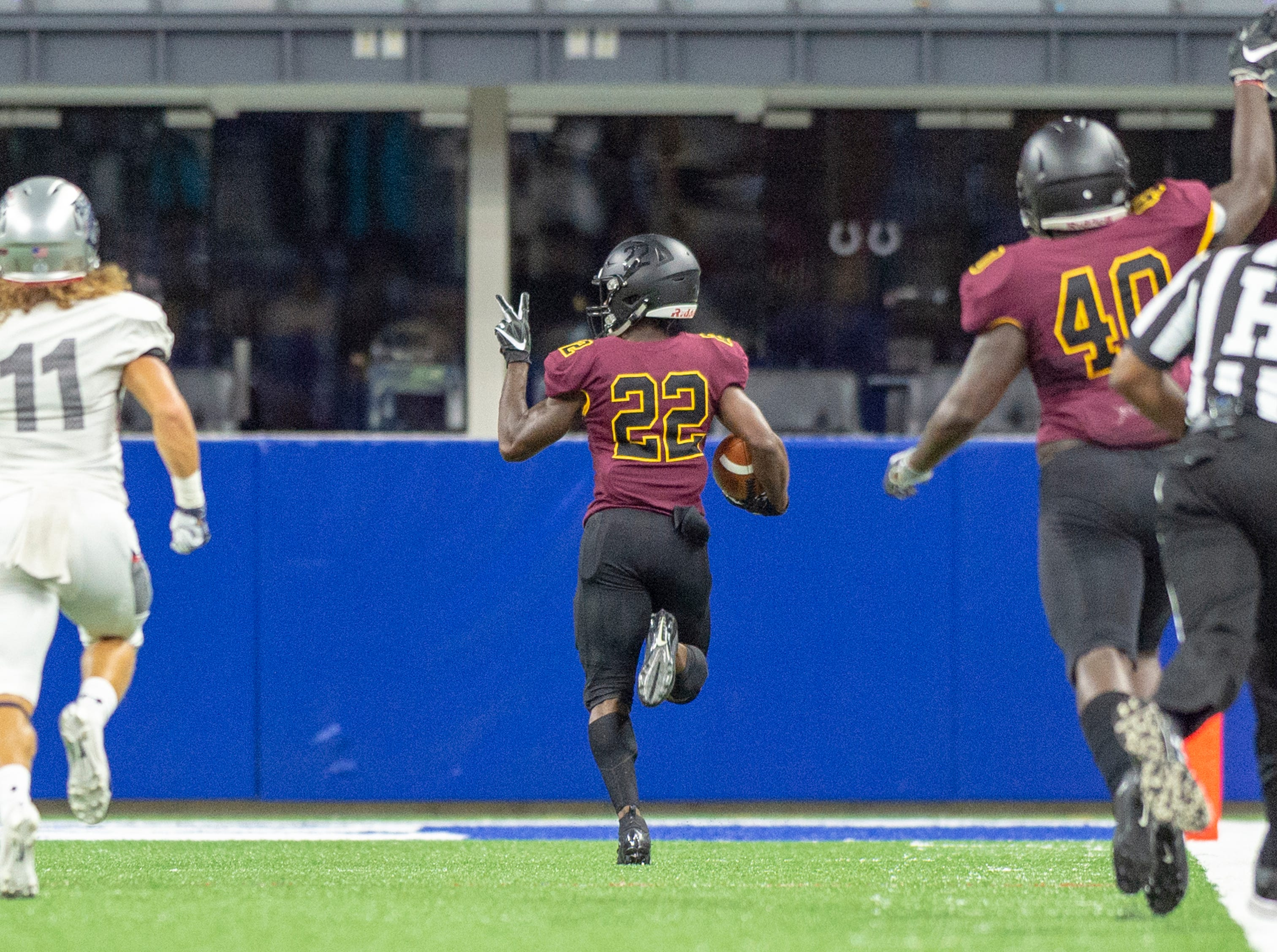 Bethune Cookman Wildcats wide receiver Jimmie Robinson (22) signals to the opposing team that this is his second kick-off runback for a touchdown in the game during the first half of action. Howard Bison took on Bethune Cookman Wildcats in the Circle City Classic game, Saturday, Sept. 22, 2018, at Lucas Oil Stadium.