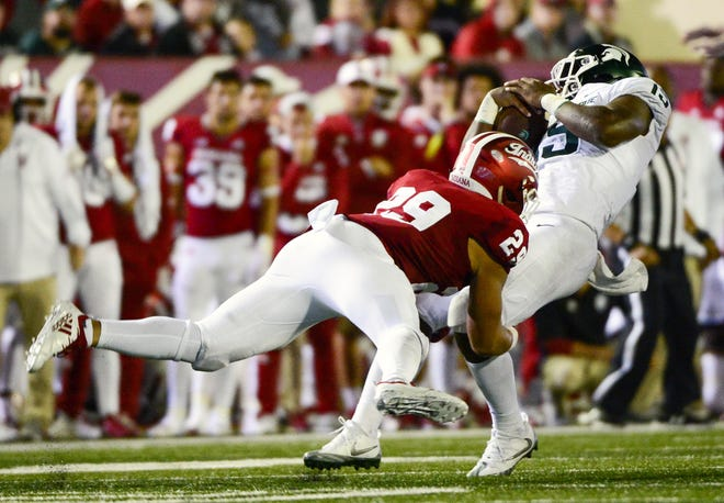 Indiana Hoosiers defensive back Khalil Bryant (29) tackles Michigan State running back La'Darius Jefferson (15) during the game against Michigan State at Memorial Stadium in Bloomington, Ind., on Saturday, Sept. 22, 2018.
