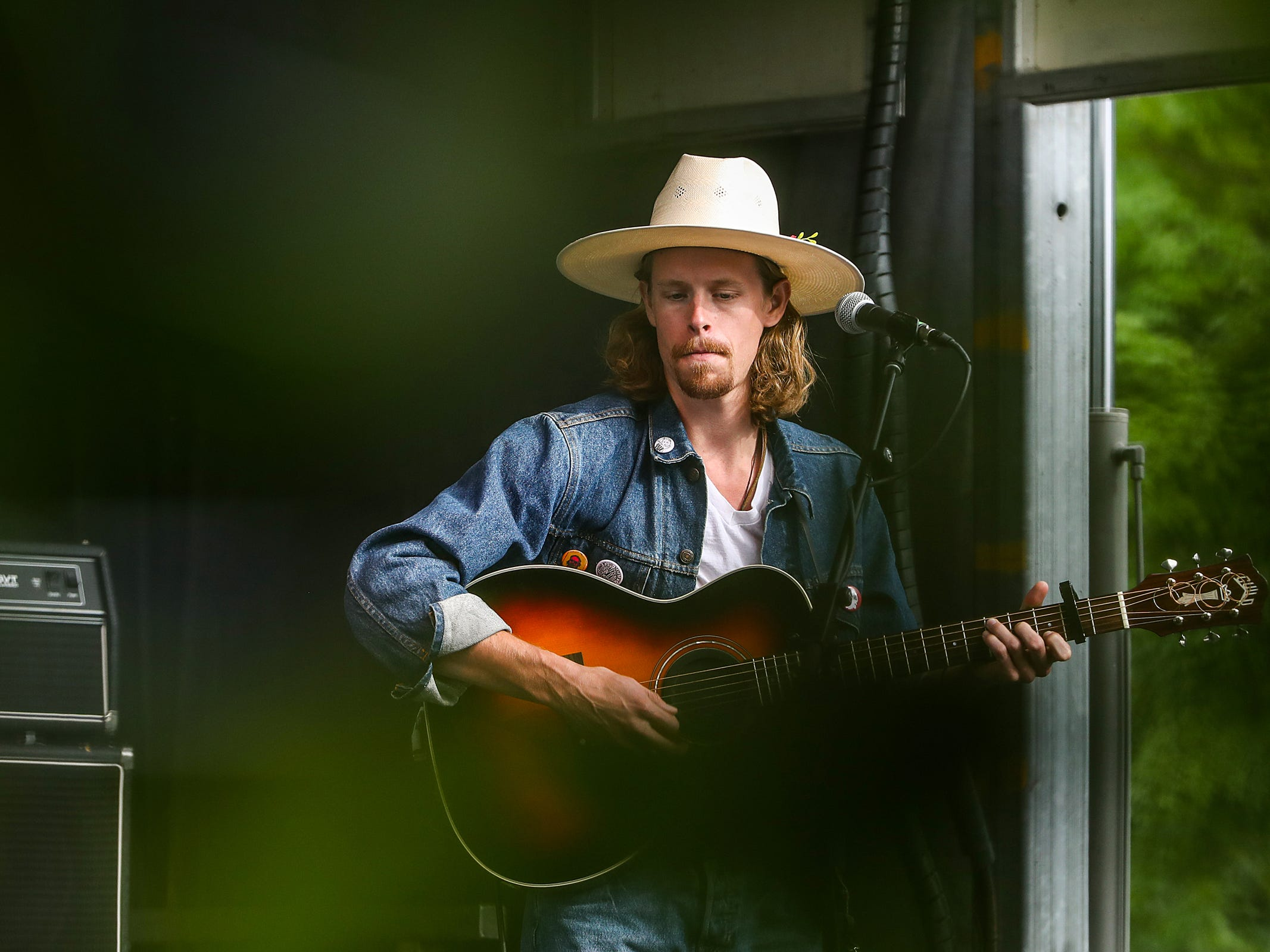 Vocalist and guitarist Taylor Meier performs with Ohio-based folk group Caamp at the inaugural Holler on the Hill music festival at Garfield Park in Indianapolis, Saturday, Sept. 22, 2018.