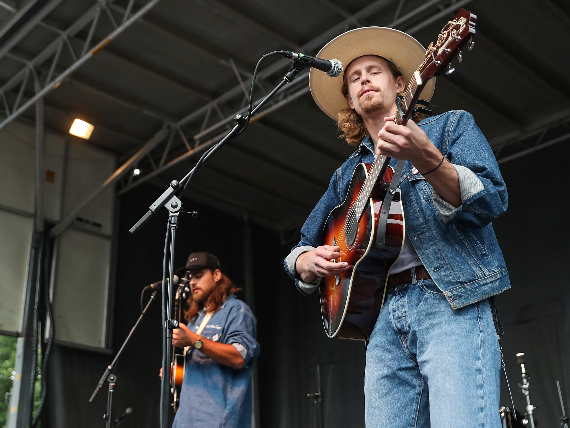 From left, Evan Westfall, Matt Vinson and Taylor Meier, of Ohio-based folk trio Caamp, perform at the inaugural Holler on the Hill music festival at Garfield Park in Indianapolis, Saturday, Sept. 22, 2018.