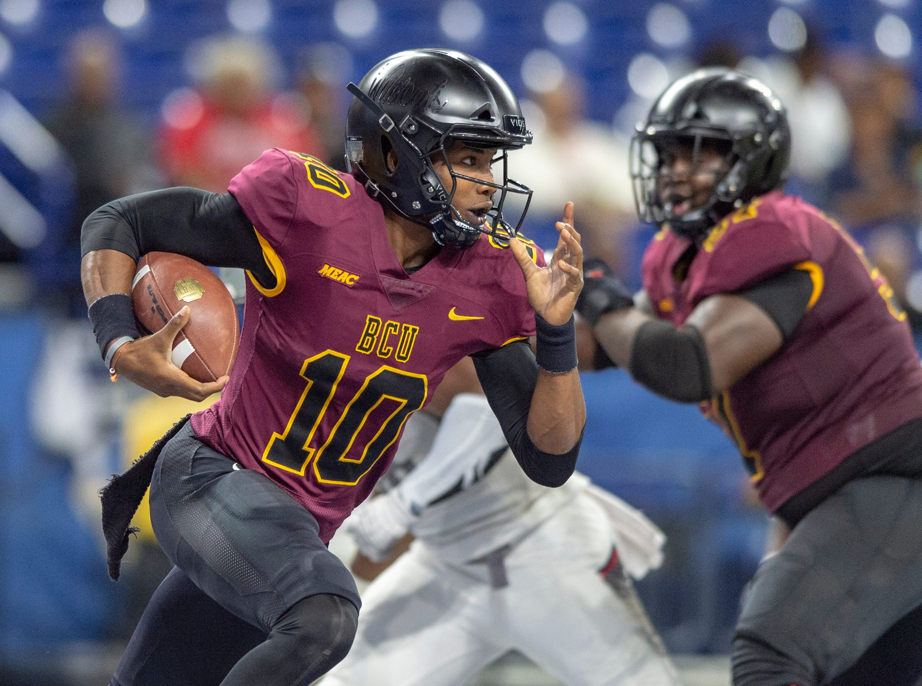 Bethune Cookman Wildcats quarterback Akevious Williams (10) rushes the ball out of the backfield during the first half of action. Howard Bison took on Bethune Cookman Wildcats in the Circle City Classic game, Saturday, Sept. 22, 2018, at Lucas Oil Stadium.