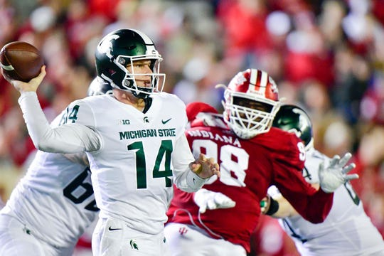 Sep 22, 2018; Bloomington, IN, USA; Michigan State Spartans quarterback Brian Lewerke (14) attempts a pass under pressure from Indiana Hoosiers defensive lineman Jerome Johnson (98) during the first half at Memorial Stadium. Mandatory Credit: Marc Lebryk-USA TODAY Sports