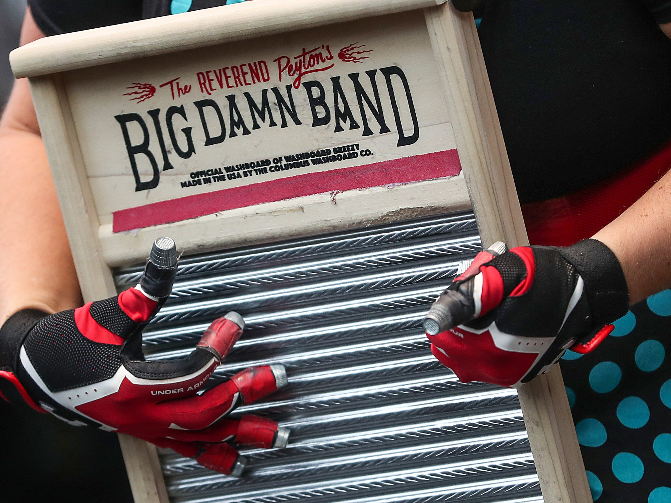 """""""Washboard"""" Breezy Peyton performs in three-piece country blues group Reverend Peyton's The Big Damn Band, of Brown County, Ind., at the inaugural Holler on the Hill music festival at Garfield Park in Indianapolis, Saturday, Sept. 22, 2018."""