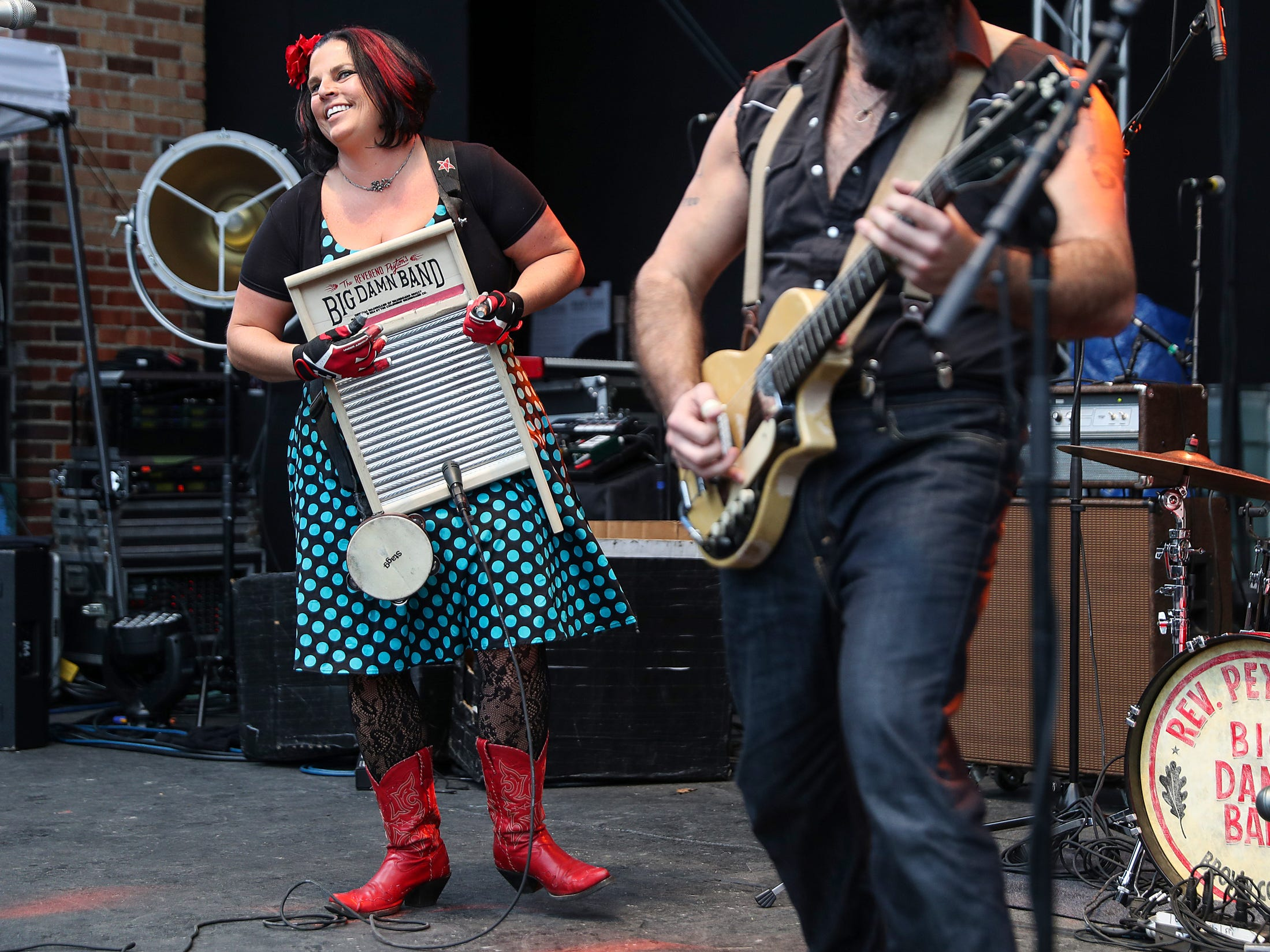 """From left, """"Washboard"""" Breezy Peyton and Reverend Peyton perform in their three-piece country blues group The Big Damn Band, of Brown County, Ind., at the inaugural Holler on the Hill music festival at Garfield Park in Indianapolis, Saturday, Sept. 22, 2018."""