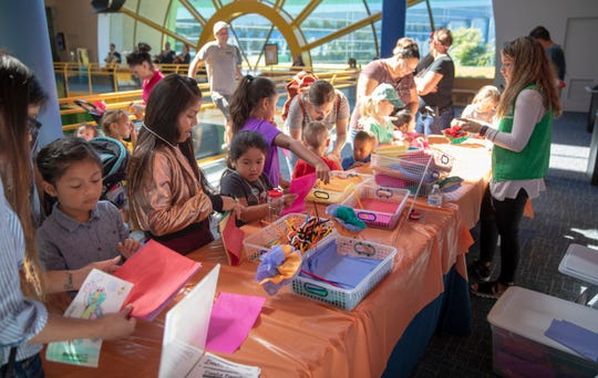 An activity table at Fiesta Familia, which translates to a party for families, at Indianapolis Children's Museum, Indianapolis, Sunday, Sept. 23, 2018. The one-day event is in Hispanic Heritage Month, and brings a taste of Latino activities and culture to the museum.