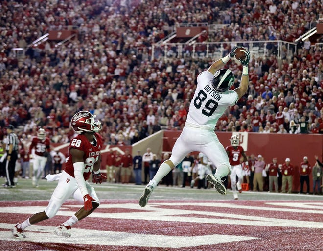 Michigan State tight end Matt Dotson (89) makes a touchdown catch against Indiana's A'Shon Riggins during the first half of an NCAA college football game, Saturday, Sept. 22, 2018, in Bloomington, Ind. (AP Photo/Darron Cummings)