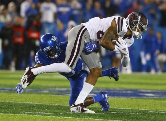 Sep 22, 2018; Lexington, KY, USA; Mississippi State Bulldogs wide receiver Osirus Mitchell (87) fights for yards against the Kentucky Wildcats in the first half at Kroger Field. Mandatory Credit: Mark Zerof-USA TODAY Sports